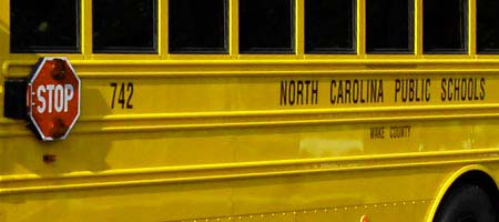 Close up of the side of a school bus
