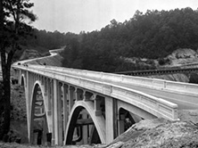 Reinforced concrete High Bridge (Henderson County Bridge 20) carrying the Spartanburg Highway/US 176 over the Green River gorge between East Flat Rock and Saluda, ca.1927 (D.H. Ramsey Library Special Collections, UNC-Asheville)