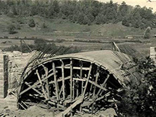 Rusticated Blue Ridge Parkway bridge (likely Allegany County Bridge 13), 1938—note reinforcing bars extended out over either side of wooden formwork in preparation for pouring of concrete arch (National Park Service, Documenting the American South, UNC-Chapel Hill)