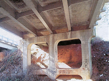 Davidson County Bridge 89 on the Lexington Bypass, built in 1950: five parallel steel I beams with transverse diaphragms supporting reinforced concrete deck (source: NCDOT bridge inspection files)
