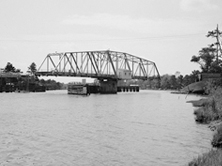 No-longer-extant Core Creek Bridge (1935), NC 101 over Intracoastal Waterway, Core Creek, Carteret County: center-bearing swing span bridge in process of turning on central pivot (Source: Library of Congress, Prints & Photographs Division, HAER, Reproduction number HAER NC-47-8)
