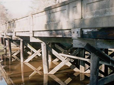 No-longer-standing Kirby's Creek Bridge (Northampton County Bridge 77) north of Conway, built in 1935: timber stringers and substructure and state-standard reinforced concrete railings (source: NCDOT bridge inspection files)