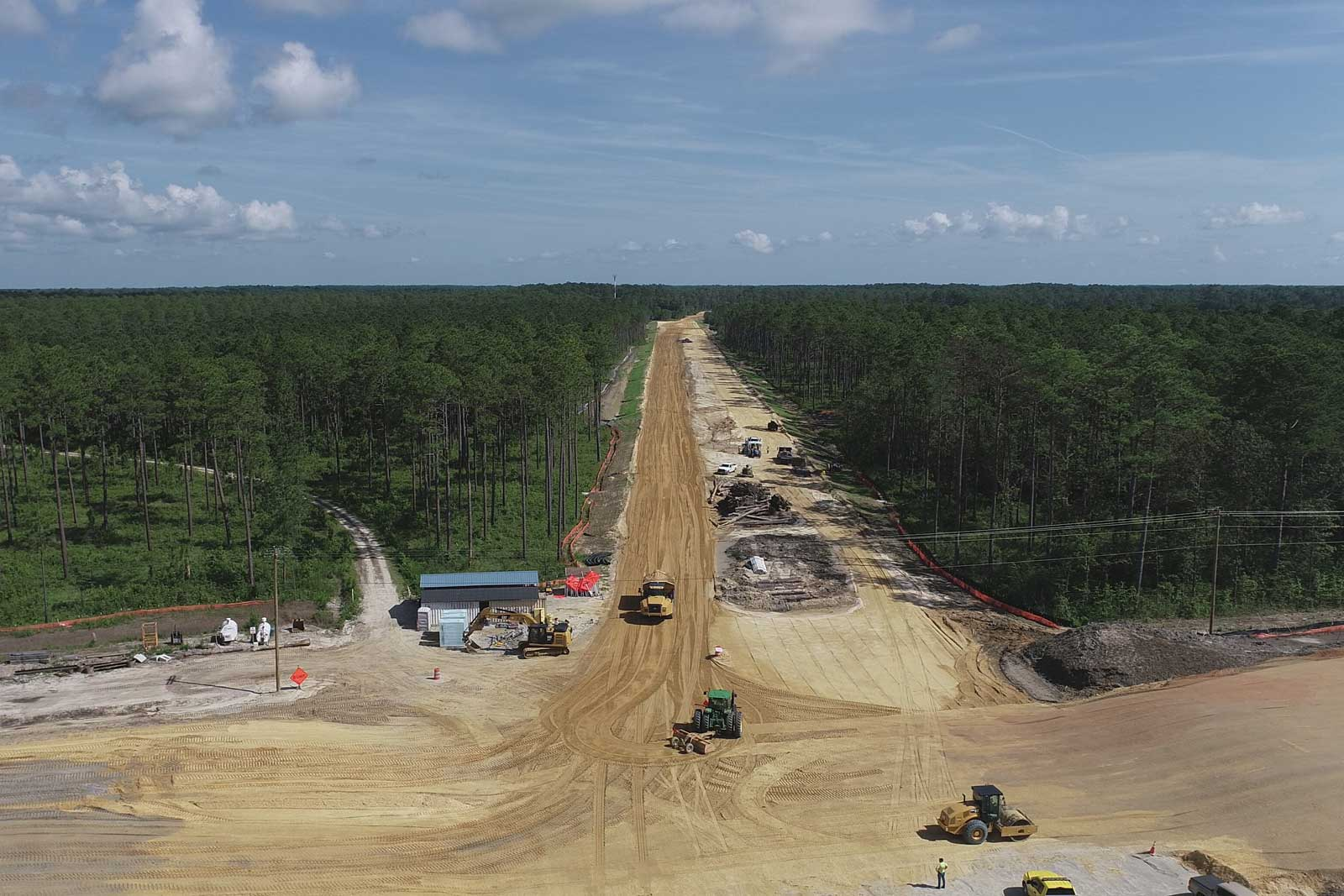 Grading and hauling operations are underway on the new alignment of the bypass. This is looking north from Sunset Drive.